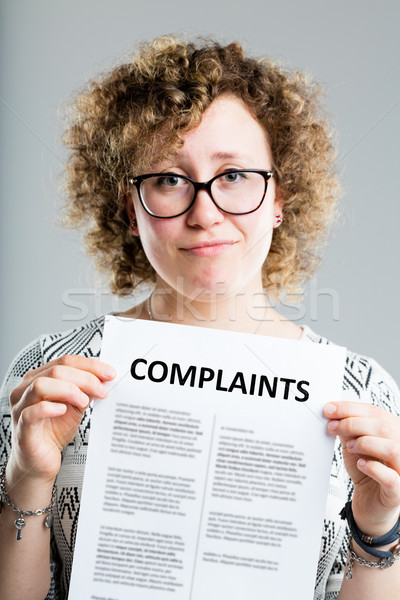 unhappy woman showing a complaints form Stock photo © Giulio_Fornasar