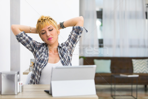 Thoughtful young woman pausing for a stretch Stock photo © Giulio_Fornasar