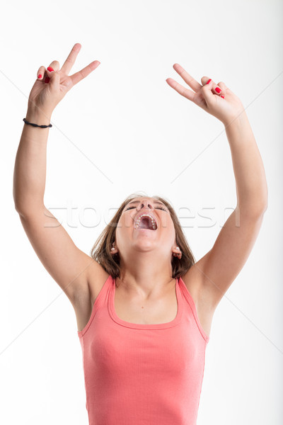 Victorious young woman cheering and laughing Stock photo © Giulio_Fornasar