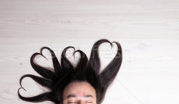 four hearts of hair over man's head Stock photo © Giulio_Fornasar