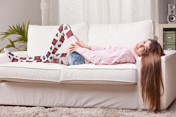 girl talking to the camera from a couch Stock photo © Giulio_Fornasar