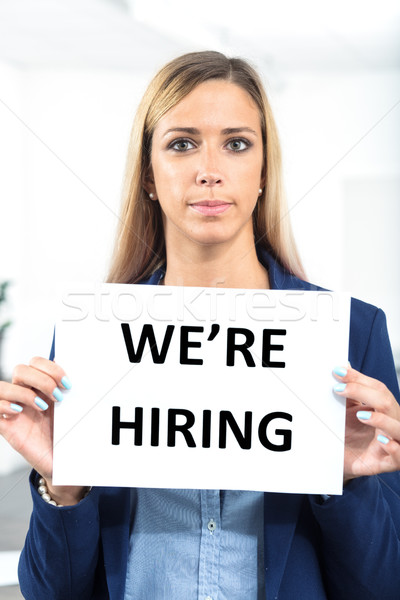 woman holding hiring sign in a worklace bacground Stock photo © Giulio_Fornasar