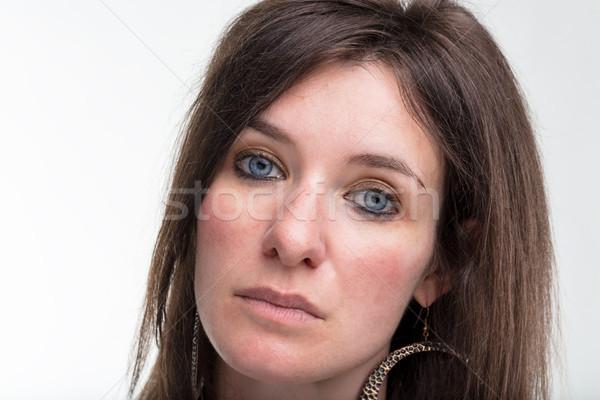 Grave ojos azules mujer primer plano retrato blanco Foto stock © Giulio_Fornasar