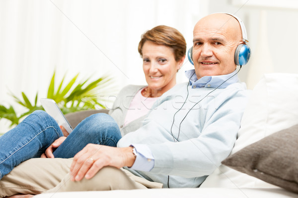Couple relaxing together listening to music Stock photo © Giulio_Fornasar