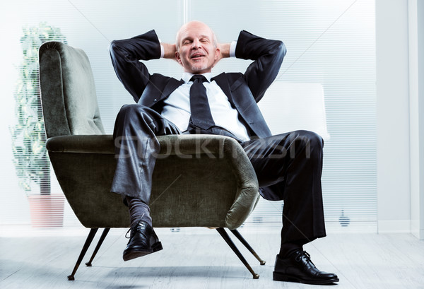 Businessman sitting relaxing and de-stressing Stock photo © Giulio_Fornasar