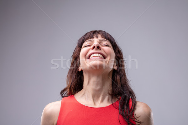 Elated relaxed woman with a beaming smile Stock photo © Giulio_Fornasar
