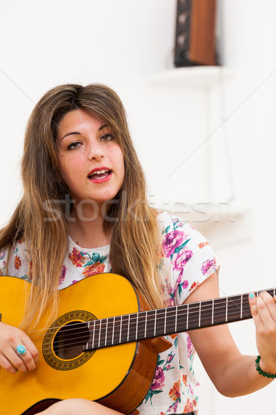 young woman or playing guitar and singing Stock photo © Giulio_Fornasar