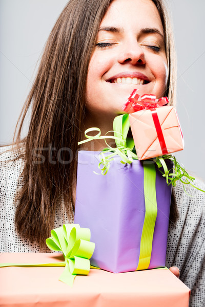 delighted woman with colorful packets Stock photo © Giulio_Fornasar