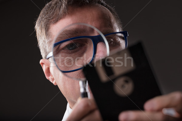 man checking data with a magnifier (data analysis concept) Stock photo © Giulio_Fornasar