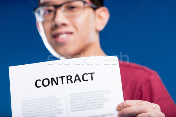 pride Chinese man holding a contract Stock photo © Giulio_Fornasar