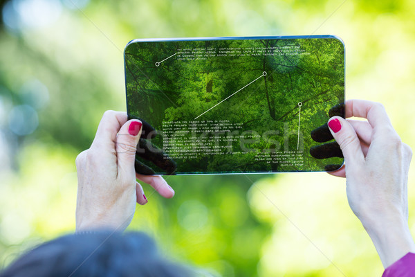 tourist using augmented reality on a transparent tablet Stock photo © Giulio_Fornasar