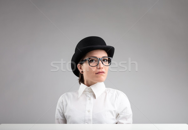 serious woman in bowler, glasses and white shirt Stock photo © Giulio_Fornasar