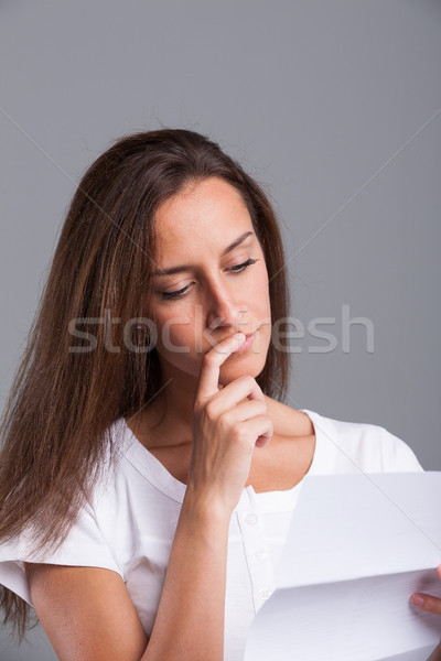 woman thinking about that letter Stock photo © Giulio_Fornasar