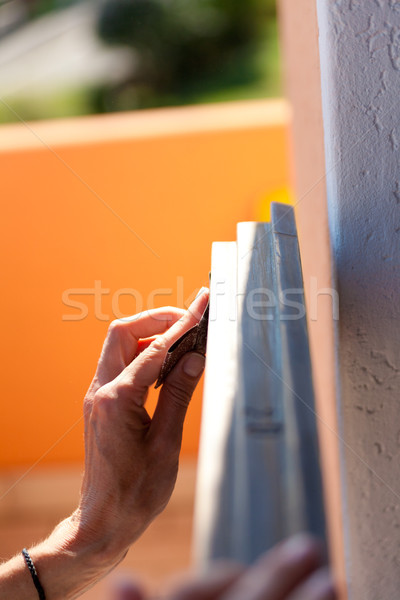 Hand of a woman sanding fixtures Stock photo © Giulio_Fornasar