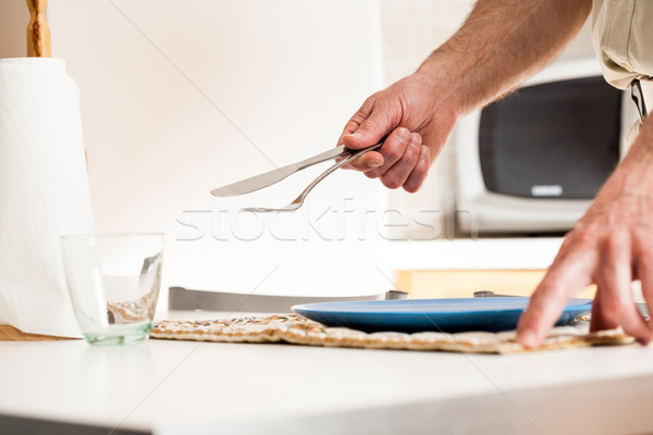 Close up of hand setting table with fork and knife Stock photo © Giulio_Fornasar