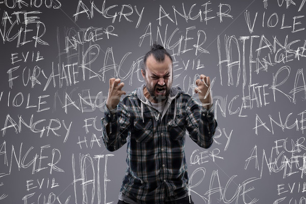 Angry screaming man full of rage and hate Stock photo © Giulio_Fornasar