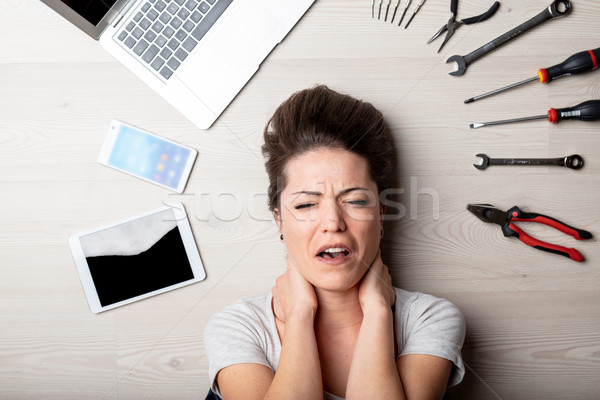 Stressed woman surrounded by hand tools Stock photo © Giulio_Fornasar