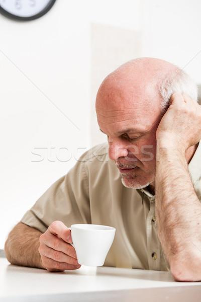 Tired senior man sitting at table indoors Stock photo © Giulio_Fornasar