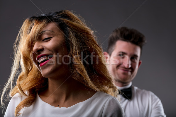 happy woman with endorsing man blurred in background Stock photo © Giulio_Fornasar