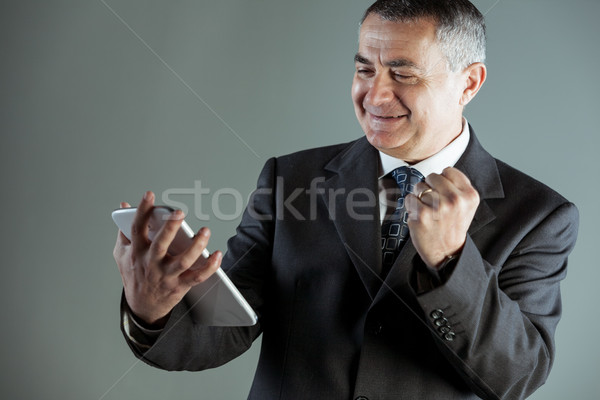 Jubilant businessman cheering a success Stock photo © Giulio_Fornasar