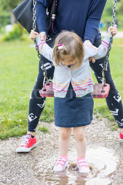 Lány pocsolya hinta kislány öröm cipők Stock fotó © Giulio_Fornasar