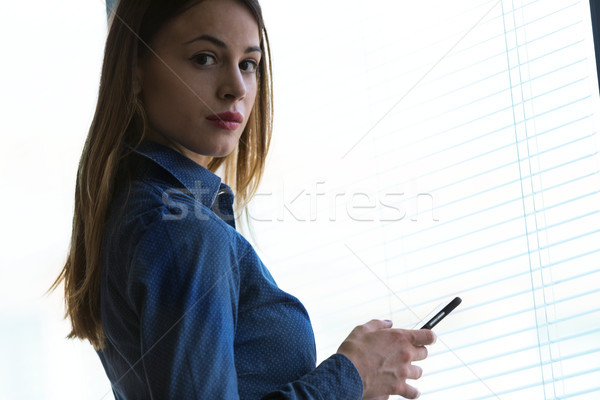 Young woman turning to stare at the camera Stock photo © Giulio_Fornasar