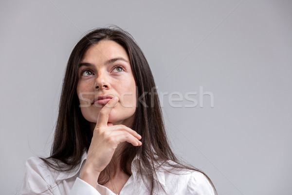 Thoughtful woman with her hand to her chin Stock photo © Giulio_Fornasar
