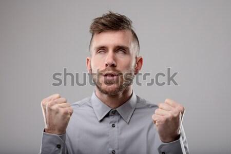 Man stijlvol kapsel tonen duim omhoog Stockfoto © Giulio_Fornasar