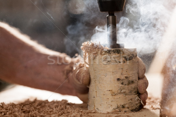 woodmaker drilling a birch log Stock photo © Giulio_Fornasar