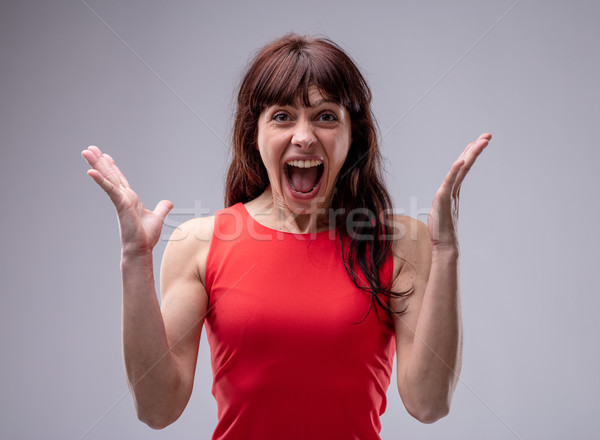 Surprised enthusiastic woman cheering Stock photo © Giulio_Fornasar