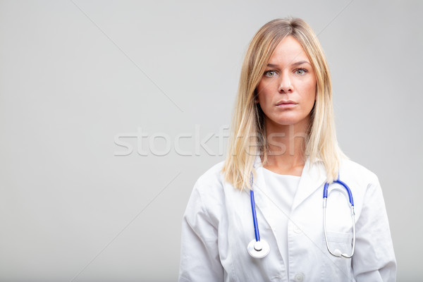 Serious intense young female doctor or nurse Stock photo © Giulio_Fornasar