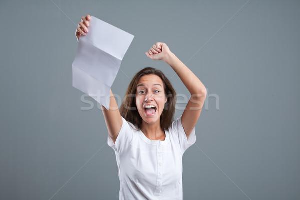 girl exulting because of good news Stock photo © Giulio_Fornasar