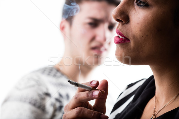 woman smoking a cigarette and disappointed man Stock photo © Giulio_Fornasar