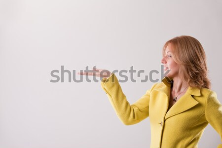 blonde woman holding up COPY SPACE Stock photo © Giulio_Fornasar