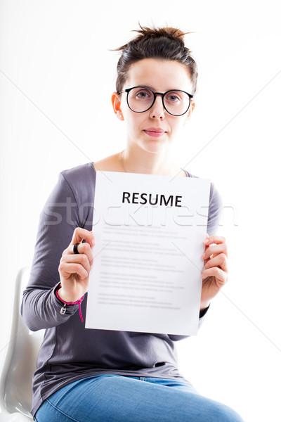 Komoly nő mutat önéletrajz szemüveg fehér Stock fotó © Giulio_Fornasar
