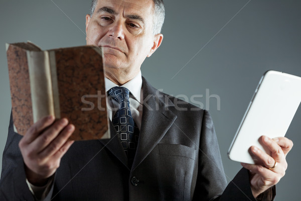 Businessman deciding between a book or e-book Stock photo © Giulio_Fornasar