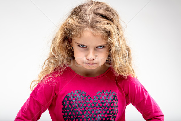 Preteen sulky girl making angry face Stock photo © Giulio_Fornasar