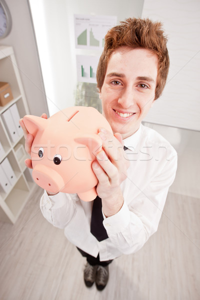 wide angle of a clerk with a piggy bank Stock photo © Giulio_Fornasar