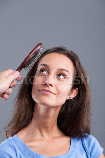woman comb with a hairbrush Stock photo © Giulio_Fornasar