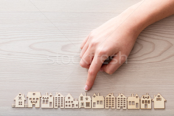 hand pointing out a house among the others mini figures in a mic Stock photo © Giulio_Fornasar