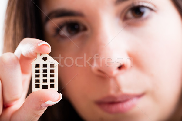 little house in foreground held by a woman Stock photo © Giulio_Fornasar