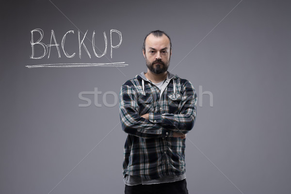 Confident man with folded arms and a sign Backup Stock photo © Giulio_Fornasar
