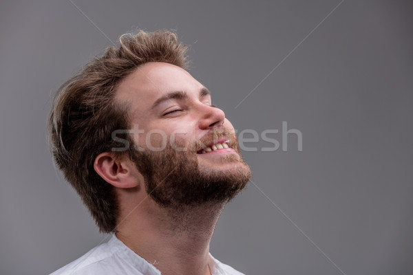 Blissful young man with his head tilted back Stock photo © Giulio_Fornasar
