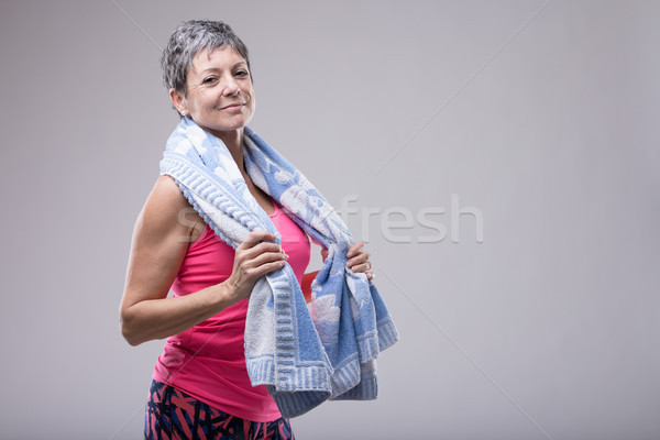 Fit attractive woman with a towel around her neck Stock photo © Giulio_Fornasar