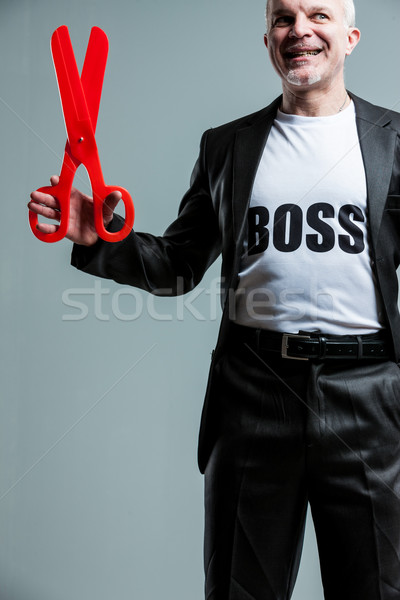 Happy mature boss man with large scissors Stock photo © Giulio_Fornasar