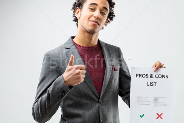 Otimista lista jovem polegar para cima sucesso Foto stock © Giulio_Fornasar