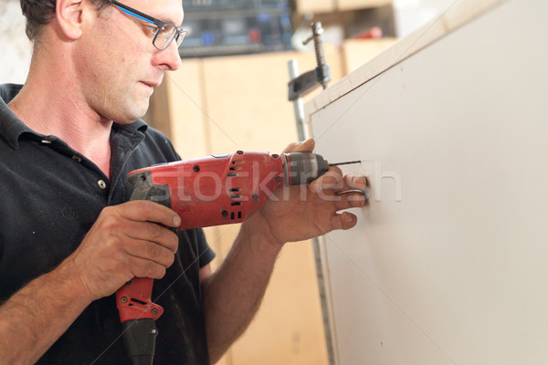 man drilling a piece of furniture Stock photo © Giulio_Fornasar