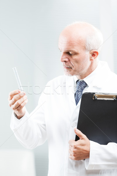chemist researcher looking at a phiale Stock photo © Giulio_Fornasar