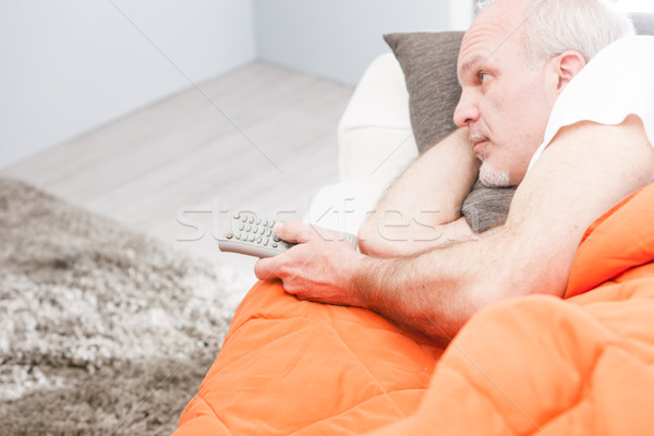Senior uomo telecomando divano Foto d'archivio © Giulio_Fornasar