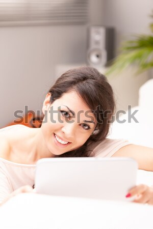 relaxed woman thinking on her sofa Stock photo © Giulio_Fornasar